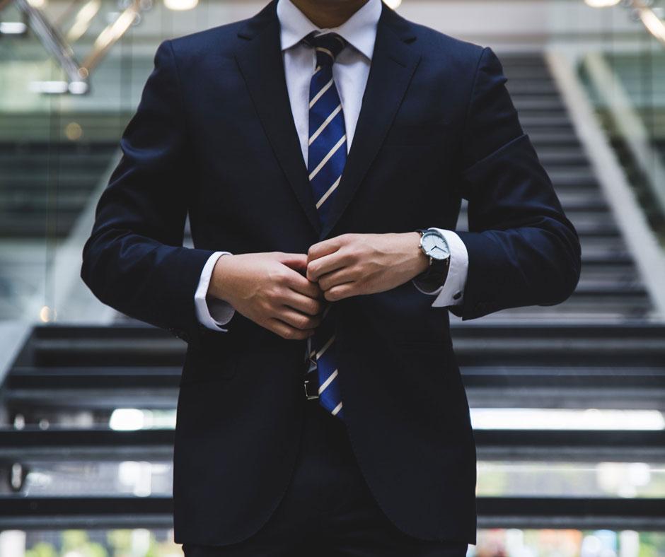 Model business man fixing tie