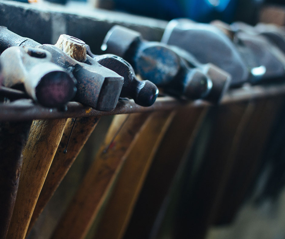 Set of tools for leaders - a picture of hammers in a row